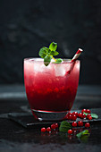 A cocktail made with vodka, grapefruit juice and redcurrant juice (a twist on a Sea Breeze)