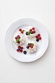 Mini meringues with cream and berries