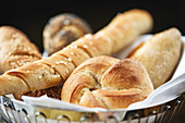 Assorted bread rolls in a bread basket