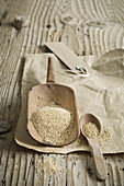 Organic amaranth on a wooden scoop on a rustic wooden table