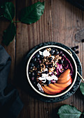 Acai bowl with fresh apricots, berries and coconut chips