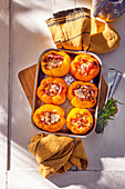 Stuffed yellow peppers with pancetta and vegetables