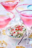 Cosmopolitan and sea bass tartare with pomegranate seeds