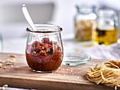 A jar of tomato pesto