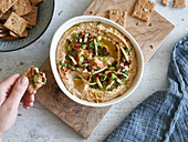An artichoke dip with spring onions