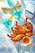 Prawns coated in kadaif with Blue Curaçao cocktails
