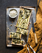 Broccolini and cheese quiche on a baking tray