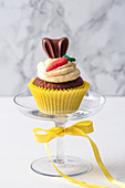Carrot cupcake on a cake stand