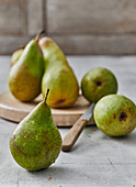 Freshly washed pears with a knife