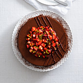 Chocolate cream cake with strawberries and pistachio nuts