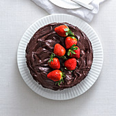 Chocolate cake with strawberries and white chocolate mousse