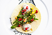 Sparagus corn taco with pomegranates and queso fresco