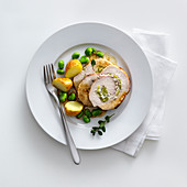 Veal roulade with a broad bean and goat's cream cheese filling and savoury
