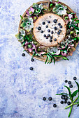 Blueberry yoghurt cake decoration with flowers