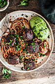 Vegan black bean balls with soba noodles, ajvar and parsley