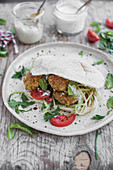 Falafel in homemade pita bread, served with fresh veggies, herbs and yoghurt sauce