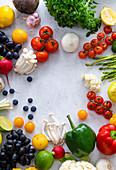 Various summer vegetables and fruits - Enoki mushrooms, asparagus, cherry tomatoes and berries