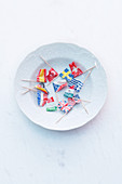 Small paper flags on a white plate