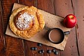 Ensaïmada de Mallorca (yeast dough pastry) with icing sugar