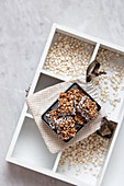 Buckwheat crispbread or puffed buckwheat with chocolate on wooden vintage textural box