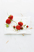 Various strawberries on kitchen paper