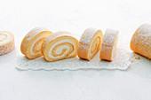 Sliced lemon Swiss roll on a doily