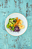 Coconut millet with tempeh, red coleslaw and salad with a pear dressing
