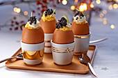 Stuffed eggs with caviar and sour cream