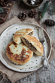 Potato cakes filled with cabbage and mushrooms (farszynki)