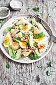 Potato salad with boiled egg, avocado, fresh cilantro and chipotle dressing