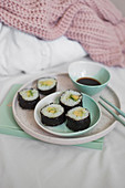 Homemade vegan sushi filled with avocado