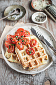 Savory cheese waffles served with roasted cherry toamtoes and chopped fresh parsley