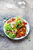 A colourful salad with marinated tomato tofu