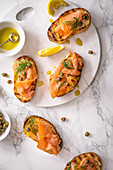 Smoked salmon crostini with capers, dill, olive oil and lemon