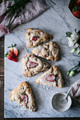 Strawberry scones on marble table