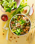 Millet bowl with sweetcorn, cos lettuce, peanuts and guacamole