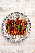 Grilled tofu skewers and tempeh skewers