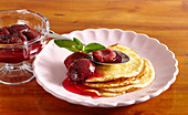Pancakes with damson compote and fresh mint