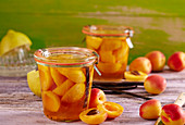Apricot compote with vanilla in preserving jars