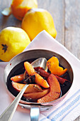 Quinces preserved in spiced red wine with star anise, cardamom, cinnamon and lemon