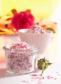 A homemade sugar mixture with fresh rose petals