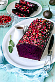 Chocolate cake with beetroot, decorated with melted chocolate, freeze-dried strawberries and chocolate dragee