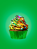A cupcake against a green background