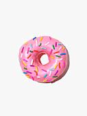 A doughnut with pink icing sugar