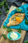Khachapuri with spinach and egg