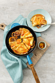 Crepe Suzette (pancakes with orange liqueur and orange juice sauce, France)