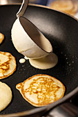 Blinis being made