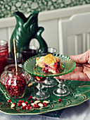 A slice of puff pastry cake with pomegranate