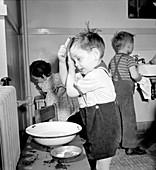 Pre-School Child Combing Own Hair, 1943