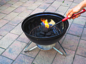 Burning Charcoal in a Barbecue Grill, 2 of 4